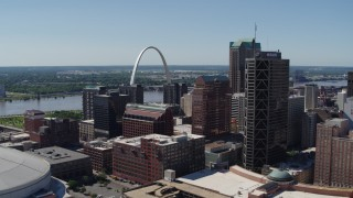 DX0001_000621 - 5.7K stock footage aerial video of the Gateway Arch behind office buildings in Downtown St. Louis, Missouri