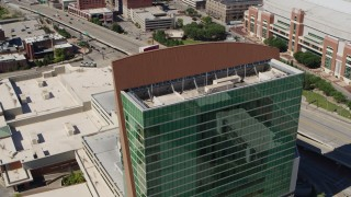 DX0001_000637 - 5.7K stock footage aerial video orbit the Four Seasons Hotel, tilt to reveal Gateway Arch, Downtown St. Louis, Missouri