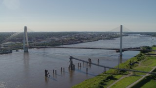 DX0001_000647 - 5.7K stock footage aerial video of approaching the Stan Musail Veterans Memorial Bridge and Mississippi River in St. Louis, Missouri