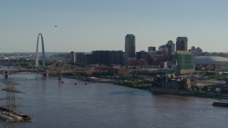 DX0001_000661 - 5.7K stock footage aerial video flying over the river to approach hotels and Downtown St. Louis, Missouri