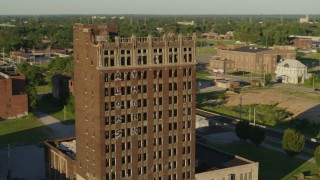 DX0001_000672 - 5.7K stock footage aerial video of circling an abandoned brick building at sunset in East St. Louis, Illinois