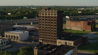 DX0001_000674 - 5.7K stock footage aerial video of flying away from an abandoned office building at sunset, East St. Louis, Illinois