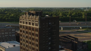 DX0001_000677 - 5.7K stock footage aerial video of flying around an abandoned brick building at sunset in East St. Louis, Illinois