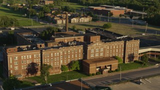 DX0001_000681 - 5.7K stock footage aerial video of an abandoned hospital at sunset in East St. Louis, Illinois