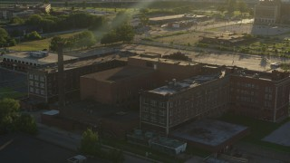 DX0001_000682 - 5.7K stock footage aerial video orbit abandoned hospital at sunset in East St. Louis, Illinois