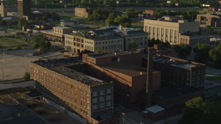 DX0001_000683 - 5.7K stock footage aerial video orbit abandoned hospital across from a federal courthouse at sunset in East St. Louis, Illinois