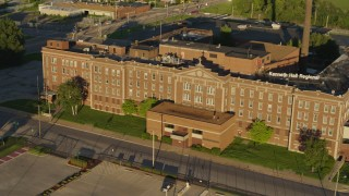DX0001_000684 - 5.7K stock footage aerial video orbit and fly away from abandoned hospital at sunset in East St. Louis, Illinois