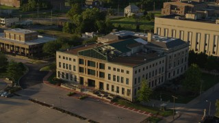 DX0001_000691 - 5.7K stock footage aerial video of flying around a federal courthouse at sunset in East St. Louis, Illinois
