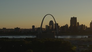 DX0001_000699 - 5.7K stock footage aerial video of a view across the river at Gateway Arch and Downtown St. Louis, Missouri at sunset