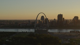 DX0001_000705 - 5.7K stock footage aerial video of the Gateway Arch at sunset, across the river in Downtown St. Louis, Missouri