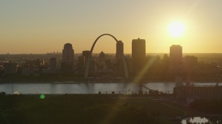 DX0001_000708 - 5.7K stock footage aerial video of the setting sun behind the Gateway Arch and Downtown St. Louis, Missouri