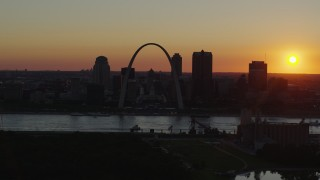 DX0001_000724 - 5.7K stock footage aerial video of the setting sun, the Gateway Arch and Downtown St. Louis, Missouri skyline
