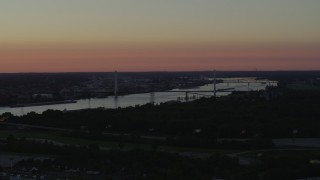 DX0001_000727 - 5.7K stock footage aerial video of the Stan Musial Veterans Memorial Bridge and Mississippi River at sunset in St. Louis, Missouri