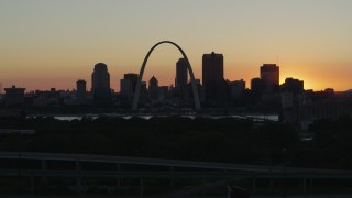 DX0001_000728 - 5.7K stock footage aerial video ascend and approach the Gateway Arch and Downtown St. Louis, Missouri skyline in silhouette at sunset
