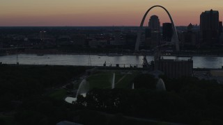 DX0001_000741 - 5.7K stock footage aerial video of the Gateway Geyser with the Arch across the river, Downtown St. Louis, Missouri, twilight