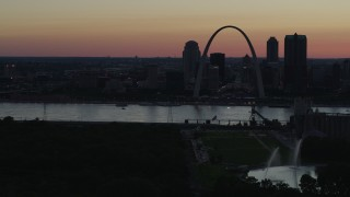 DX0001_000747 - 5.7K stock footage aerial video of the city skyline in silhouette, Downtown St. Louis, Missouri, twilight