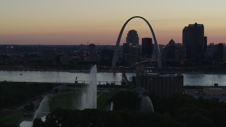 DX0001_000750 - 5.7K stock footage aerial video water from Gateway Geyser and the Gateway Arch, Downtown St. Louis, Missouri, twilight