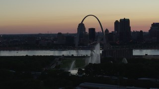 DX0001_000752 - 5.7K stock footage aerial video fly away from Gateway Geyser, with view of Downtown St. Louis, Missouri, twilight