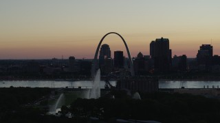 DX0001_000754 - 5.7K stock footage aerial video ascend to approach Gateway Geyser, and the Arch in Downtown St. Louis, Missouri, twilight