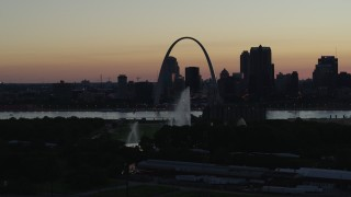 DX0001_000757 - 5.7K stock footage aerial video a static view of the Gateway Geyser, and the Arch in Downtown St. Louis, Missouri, twilight