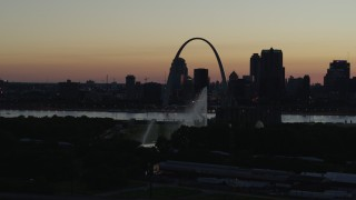 DX0001_000759 - 5.7K stock footage aerial video fly way from Gateway Arch in Downtown St. Louis, Missouri, twilight, and the Gateway Geyser