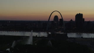 DX0001_000763 - 5.7K stock footage aerial video pass the Gateway Geyser with view of Downtown St. Louis, Missouri, twilight