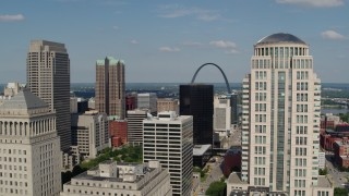 DX0001_000778 - 5.7K stock footage aerial video of a view across the city to the museum by the Gateway Arch in Downtown St. Louis, Missouri