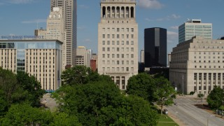 DX0001_000786 - 5.7K stock footage aerial video ascend by courthouse and reveal Gateway Arch in Downtown St. Louis, Missouri