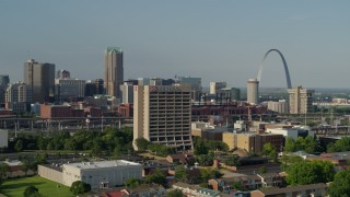 DX0001_000813 - 5.7K stock footage aerial video of passing an office building with the Gateway Arch in background, Downtown St. Louis, Missouri