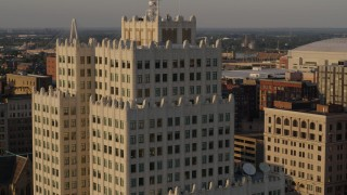 DX0001_000841 - 5.7K stock footage aerial video of flying away from an apartment building at sunset, Downtown St. Louis, Missouri