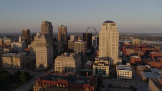DX0001_000845 - 5.7K stock footage aerial video of flying by courthouses to reveal Gateway Arch and museum at sunset, Downtown St. Louis, Missouri