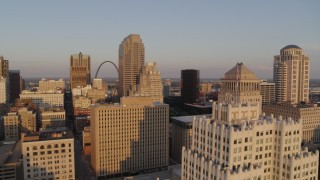 DX0001_000851 - 5.7K stock footage aerial video flyby office building snd courthouse to reveal Arch at sunset, Downtown St. Louis, Missouri