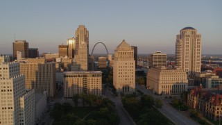 DX0001_000855 - 5.7K stock footage aerial video approach courthouses with view of the Gateway Arch at sunset, Downtown St. Louis, Missouri