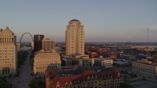 DX0001_000859 - 5.7K stock footage aerial video flyby courthouse buildings to reveal the Arch at sunset, Downtown St. Louis, Missouri