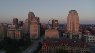 DX0001_000869 - 5.7K stock footage aerial video of passing courthouses with view of the Arch, reveal city hall at sunset, Downtown St. Louis, Missouri