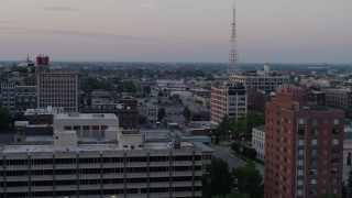 DX0001_000879 - 5.7K stock footage aerial video flyby brick office building for a wider view of neighborhood at twilight, Downtown St. Louis, Missouri