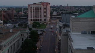 DX0001_000881 - 5.7K stock footage aerial video light street traffic between hotel and arena at twilight, Downtown St. Louis, Missouri