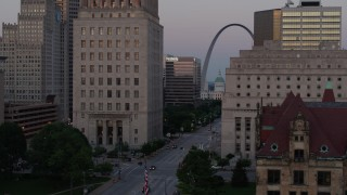 DX0001_000883 - 5.7K stock footage aerial video flyby courthouses, reveal light street traffic, the Gateway Arch at twilight, Downtown St. Louis, Missouri