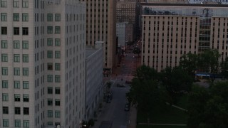 DX0001_000884 - 5.7K stock footage aerial video flyby office building to reveal city street at twilight, Downtown St. Louis, Missouri