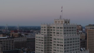 DX0001_000887 - 5.7K stock footage aerial video of orbiting the top of a downtown apartment building at twilight, Downtown St. Louis, Missouri