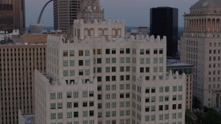 DX0001_000888 - 5.7K stock footage aerial video of circling the top of a downtown apartment building at twilight, Downtown St. Louis, Missouri