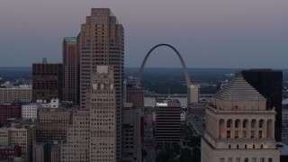 DX0001_000889 - 5.7K stock footage aerial video ascend past courthouse for a view of the Gateway Arch at twilight, Downtown St. Louis, Missouri