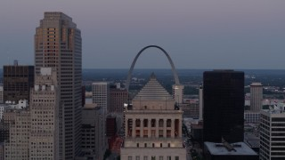 DX0001_000893 - 5.7K stock footage aerial video of the Gateway Arch at twilight, visible from a courthouse in Downtown St. Louis, Missouri