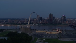 DX0001_000897 - 5.7K stock footage aerial video of the Gateway Arch at twilight seen from across the Mississippi River, Downtown St. Louis, Missouri