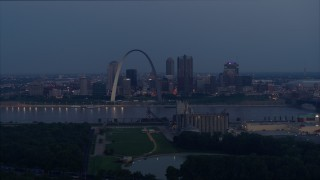 DX0001_000898 - 5.7K stock footage aerial video of the Gateway Arch at twilight across the Mississippi River, Downtown St. Louis, Missouri