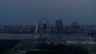 DX0001_000901 - 5.7K stock footage aerial video view across the river of the the Gateway Arch at twilight, Downtown St. Louis, Missouri