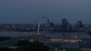 DX0001_000902 - 5.7K stock footage aerial video the Gateway Arch at twilight, across the river in Downtown St. Louis, Missouri