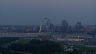 DX0001_000903 - 5.7K stock footage aerial video looking across the Mississippi River at the Gateway Arch, Downtown St. Louis, Missouri, twilight