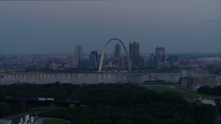 DX0001_000905 - 5.7K stock footage aerial video of the Mississippi River, the Gateway Arch, and Downtown St. Louis, Missouri, twilight