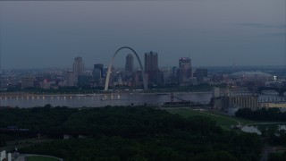DX0001_000906 - 5.7K stock footage aerial video of the Gateway Arch and Downtown St. Louis, Missouri, across the river at twilight